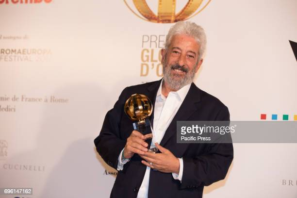 Italian director Gianfranco Cabiddu during the photocall of the 2017 Globe Awards ceremony evening in the Villa Medici Gardens