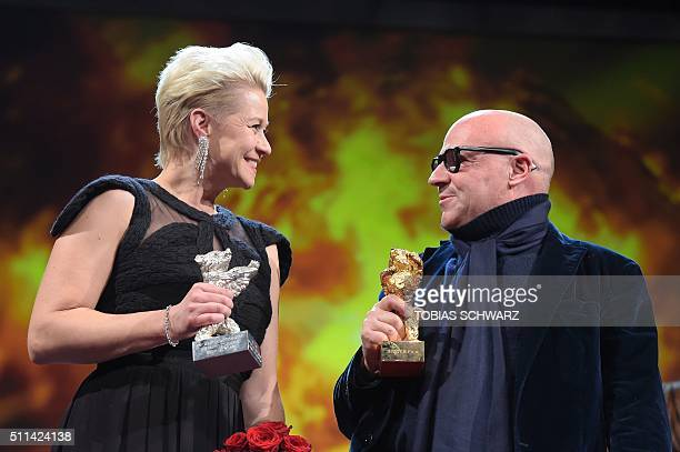 Italian director Gianfranco Rosi poses with the Golden Bear for Best Film with Danish actress Trine Dyrholm posing with Silver Bear for best actress...