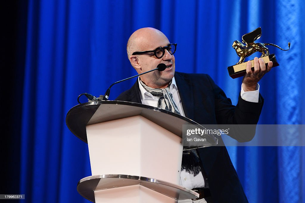 Italian director Gianfranco Rosi poses with the Golden Lion for Best Film he received for his movie 'Sacro Gra' on stage during the Closing Ceremony at the 70th Venice International Film Festival at the Palazzo del Casino on September 7, 2013 in Venice, Italy.