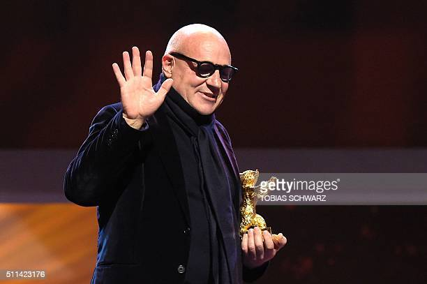Italian director Gianfranco Rosi reacts after receiving the Golden Bear for Best Film for the film 'Fuocoammare ' during the awards ceremony of the...