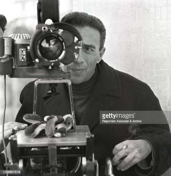 """Italian director Gianni Puccini at the camera on the set of the film """"The Attic"""". 1962"""