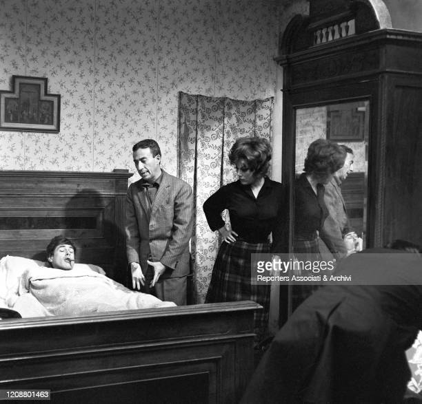 Italian director Gianni Puccini with Italian actress Daniela Rocca and Cuban-born American actor Tomas Milian during the shooting on the set of the...
