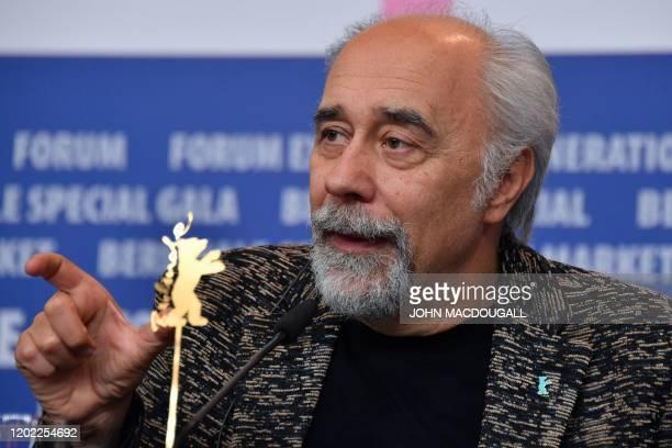 Italian director Giorgio Diritti addresses a press conference for the film Volevo Nascondermi screened in competition at the 70th Berlinale film...