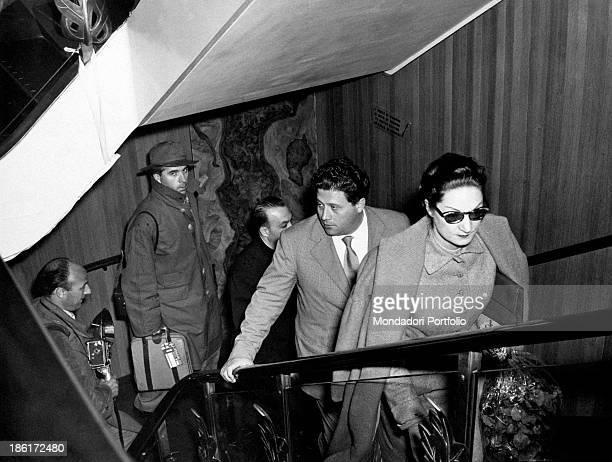 Italian director Giorgio Streheler Italian tenor Luigi Infantino and Italian actress Sarah Ferrati leaving for South America on board the...