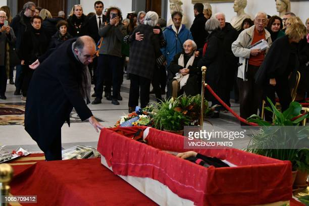 Italian director Giuseppe Tornatore and Italian director Francesco Maselli and people pay their respects to Italian film director Bernardo Bertolucci...