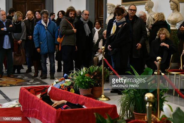 Italian director Giuseppe Tornatore Italian actress Laura Morante and people pay their respects to Italian film director Bernardo Bertolucci lying in...