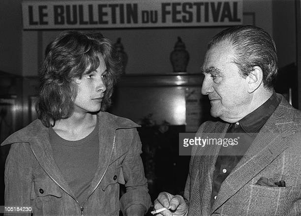 Italian director Luchino Visconti chats with young Swedish actor Bjorn Andresen 24 May 1971 in Cannes during the international film Festival Andresen...