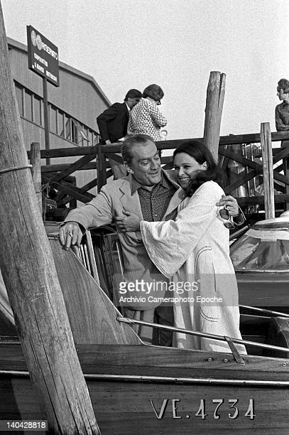 Italian director Luchino Visconti on a water taxi with Lucia Bose, Venice, 1972.