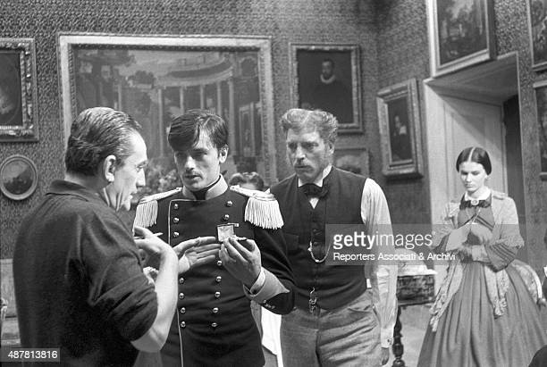 Italian director Luchino Visconti talking to French actor Alain Delon and American actor Burt Lancaster on the set of The Leopard directed by himself...