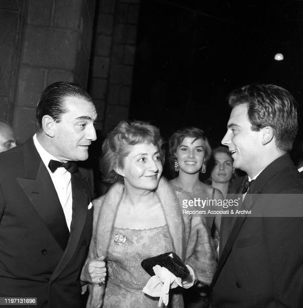Italian director Luchino Visconti talking to Italian actor Franco Interlenghi beside Italian actress Antonella Lualdi at the gala for the premiere of...