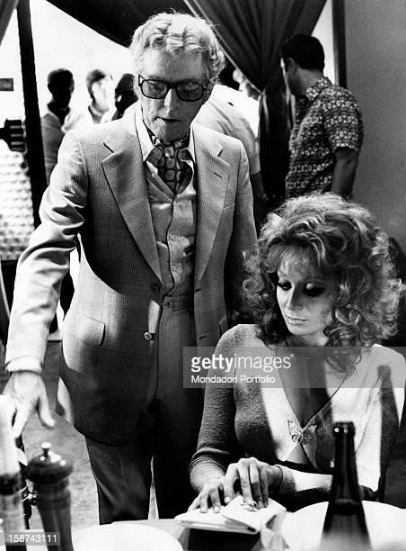 Italian director Luciano Salce with Italian actress and singer Maria Grazia Buccella on the set of the film Basta Guardarla Rome 1970s