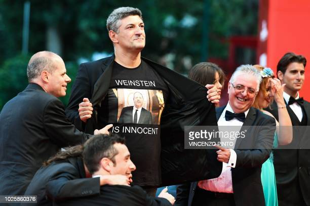Italian director Luciano Silighini Garagnani flashes a jersey reading Weinstein is innocent as he arrives for the premiere of the film Suspiria...