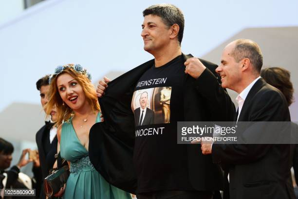 Italian director Luciano Silighini Garagnani flashes a jersey reading Weinstein is innocent as guests arrive for the premiere of the film Suspiria...