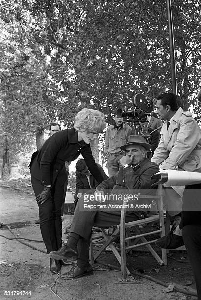 Italian director Luigi Comencini and German actress Elke Sommer speaking during a break on the set of the segment Treatise on Eugenics from the...