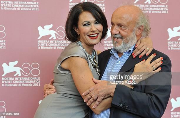 """Italian director Maria Grazia Cucinotta and actor Renato Scarpa pose during the photocall of """"Scialla!"""" and """"Il Maestro"""" during the 68th Venice..."""