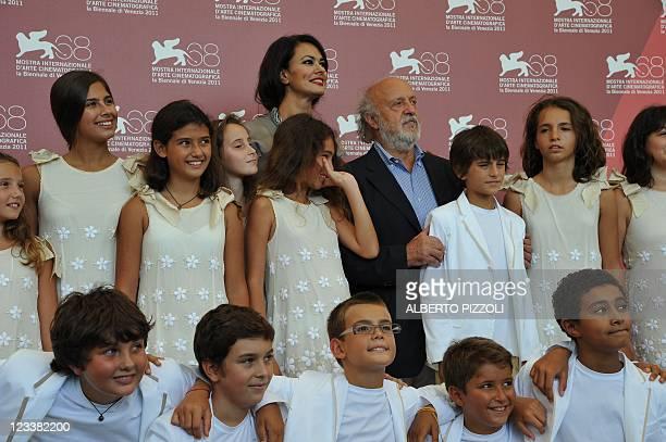 "Italian director Maria Grazia Cucinotta and actor Renato Scarpa pose with children during the photocall of ""Scialla!"" and ""Il Maestro"" during the..."