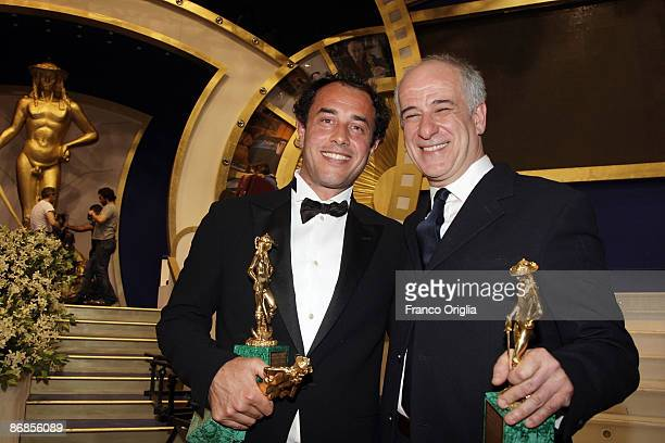 Italian director Matteo Garrone and Italian actor Tony Servillo show their awards during the Italian Movie Awards ''David Di Donatello'' at the...