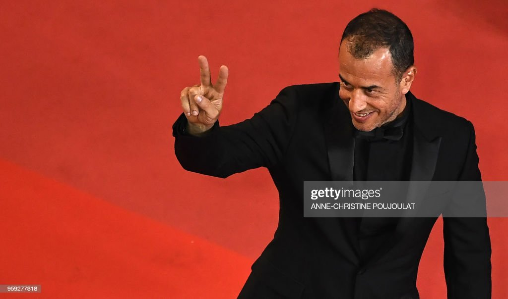 TOPSHOT - Italian director Matteo Garrone gestures as he arrives on May 16, 2018 for the screening of the film 'Dogman' at the 71st edition of the Cannes Film Festival in Cannes, southern France.