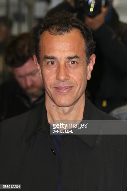 Italian director Matteo Garrone poses upon arrival to attend the UK premiere of the film Tales of Tales in central London on June 1 2016 / AFP /...