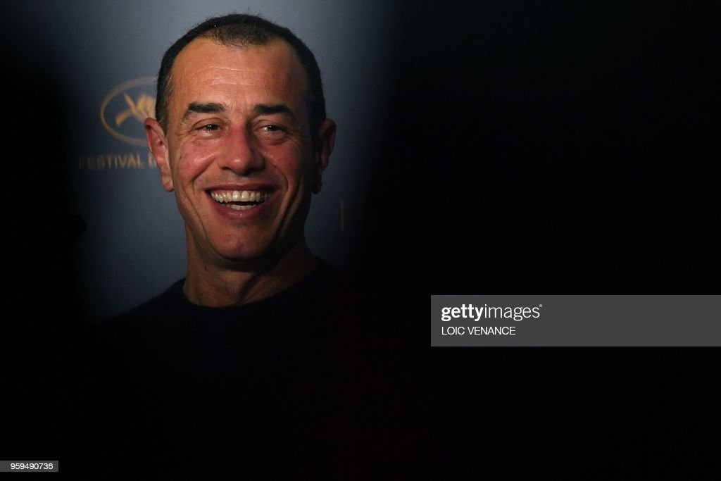 Italian director Matteo Garrone smiles on May 17, 2018 during a press conference for the film 'Dogman' at the 71st edition of the Cannes Film Festival in Cannes, southern France.