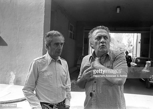 Italian director Michelangelo Antonioni visiting Italian director Federico Fellini on the set of Fellini's Casanova in Cinecittà Rome 1976