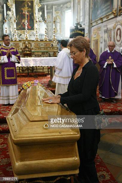 Italian director Michelangelo Antonioni's widow Enrica Fico pays respect at the coffin of her husband during the funeral in the St George basilica of...