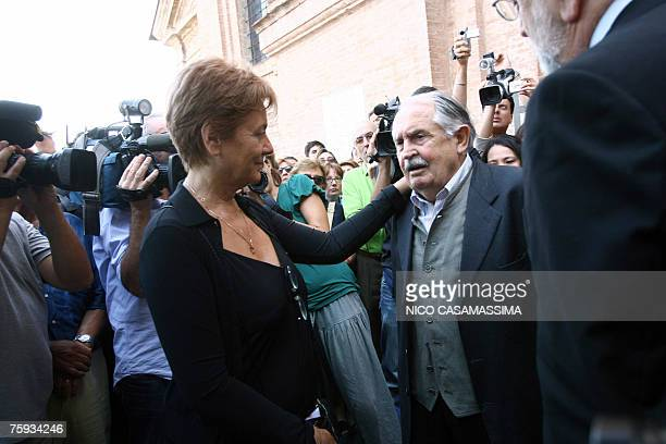 Italian director Michelangelo Antonioni's widow Enrica Fico talks with Italian script writer Tonino Guerra at the end of the funeral of her husband...