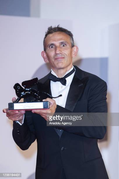 """Italian director Michelangelo Frammartino receives the Special Jury Prize for """"Il Buco"""" during the closing ceremony of the 78th Venice Film Festival..."""