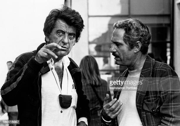 Italian director Nanni Loy and Italian actor Nino Manfredi talking on the set of Café Express Italy 1980