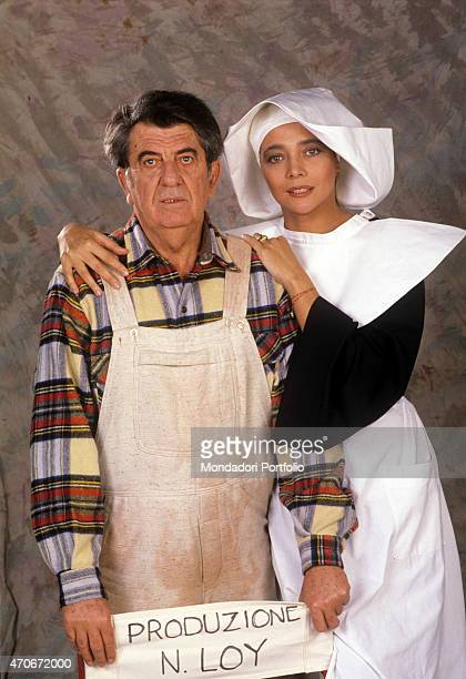 Italian director Nanni Loy directing Italian showgirl Mara Venier on the set of the TV show Candid Camera Italy 1988