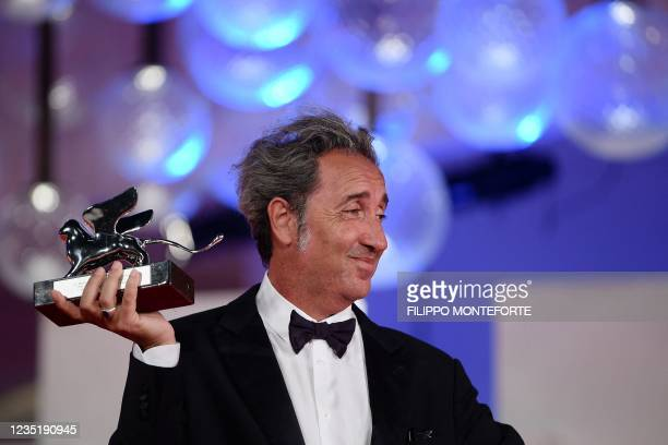 """Italian director Paolo Sorrentino poses with the Silver Lion - Grand Jury Prize he received for """"E stato la mano di Dio"""" during the Winners'..."""