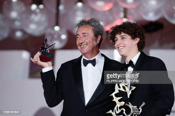 """Italian director Paolo Sorrentino poses with the Silver Lion - Grand Jury Prize he received for """"E stato la mano di Dio"""" , along with Italian actor..."""