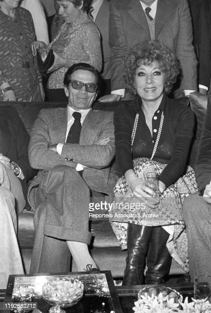 Italian director Pier Paolo Pasolini attending to a party with Italian actress Lauretta Masiero Rome 1975