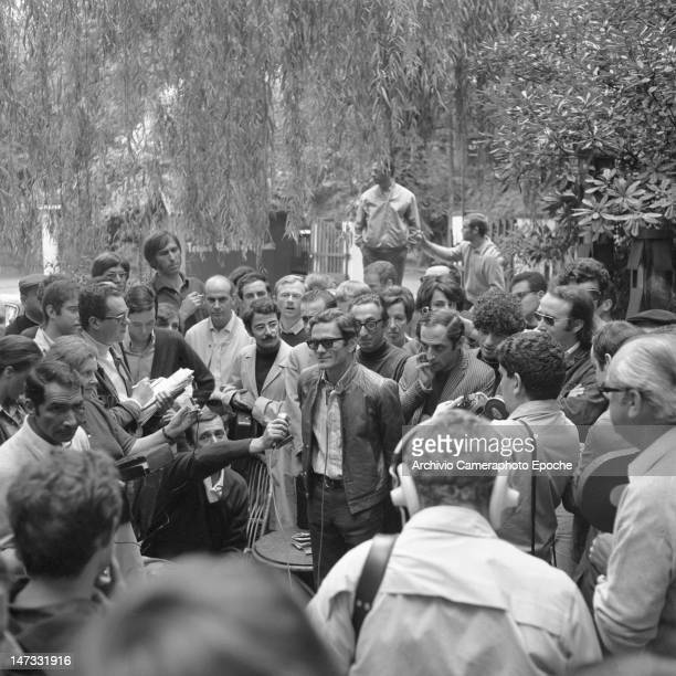 Italian director Pierpaolo Pasolini standing in a talk in during a demonstration against the Biennale Venice 1968