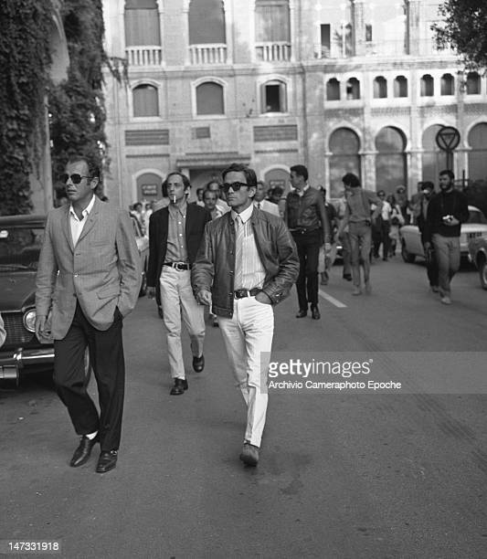Italian director Pierpaolo Pasolini walking in front of the Excelsior Hotel during a demonstration against the Biennale Lido Venice 1968