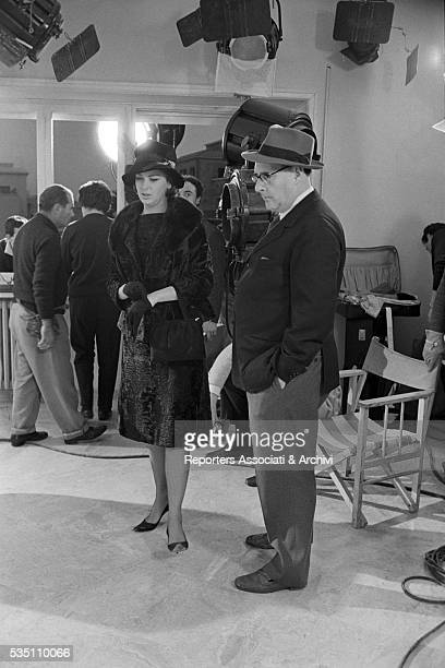 Italian director Roberto Rossellini and Danish actress Annette Stroyberg on the set of the film Black Soul Italy 1962