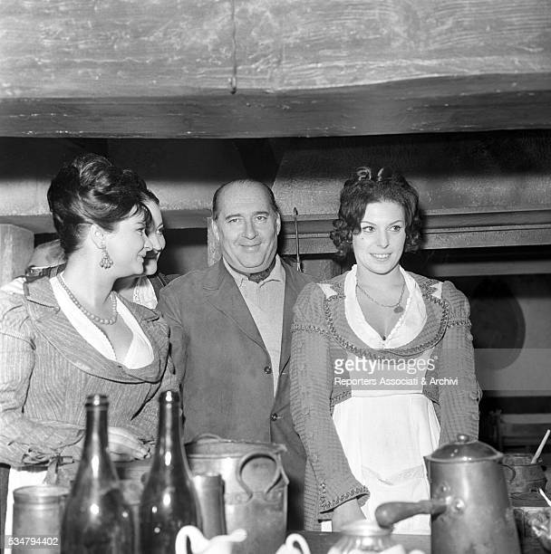 Italian director Roberto Rossellini French actress Martine Carol and American actress and soprano Anna Moffo attending a party held for the film The...
