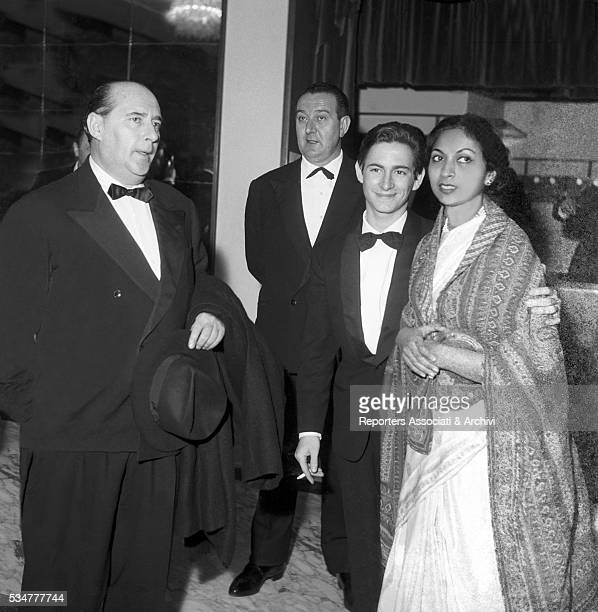 Italian director Roberto Rossellini his wife Sonali Das Gupta and his son Renzo attending a gala at the cinema Fiamma Rome 1975