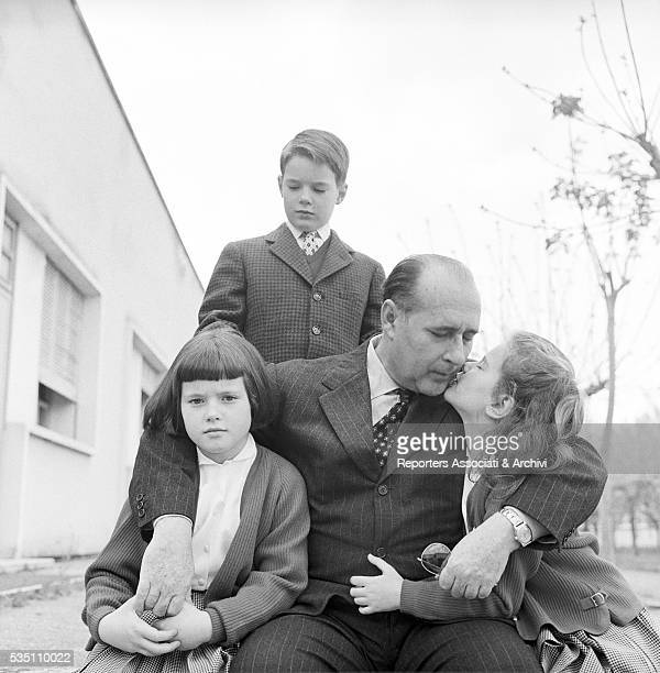 Italian director Roberto Rossellini posing with his children Robertino Isotta and Isabella Italy 1957