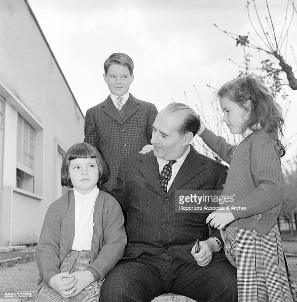 Italian director Roberto Rossellini posing with his children Robertino Isotta and Isabella Italy 1957