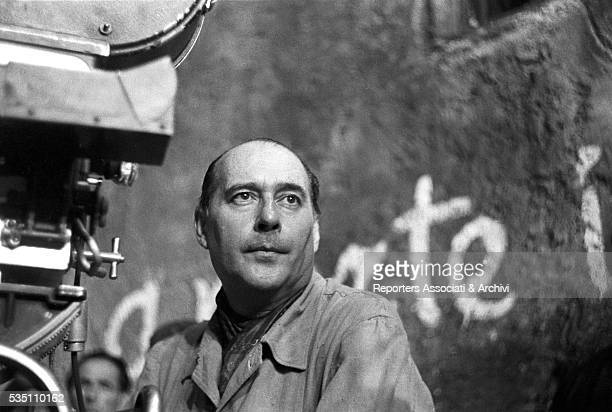 Italian director Roberto Rossellini preparing a scene on the set of General Della Rovere Italy 22nd August 1959
