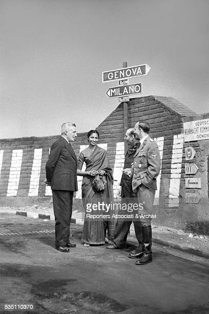 Italian director Roberto Rossellini preparing a scene with his wife Sonali Das Gupta and Italian actor Vittorio De Sica on the set of General Della...