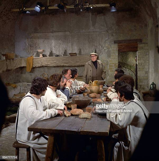 Italian director Roberto Rossellini talking to some of the cast on the set of the film Augustine of Hippo 1972