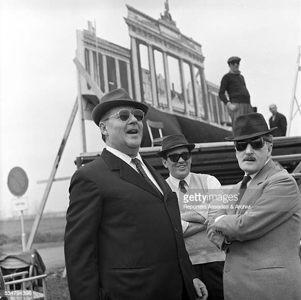 Italian director Roberto Rossellini visiting Italian actor Totò on the set of the film Toto and Peppino Divided in Berlin 1962