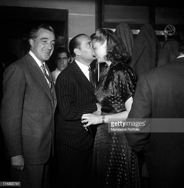 Italian director Roberto Rossellini with his Swedish partner and actress Ingrid Bergman and Italian actor and director Vittorio De Sica smiling in a...