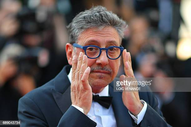 Italian director Sergio Castellitto adjusts his glasses as he arrives on May 27 2017 for the Un Certain Regard prize ceremony at the 70th edition of...
