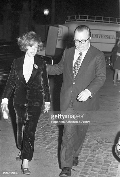 Italian director Sergio Leone and his wife Carla Ranalli walking after the Vides party Rome 29th April 1968