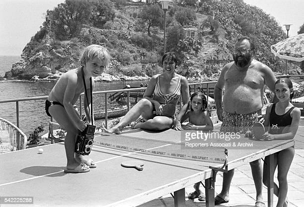 Italian director Sergio Leone and his wife Carla with their children Francesca Raffaella and Andrea playing table tennis August 1972