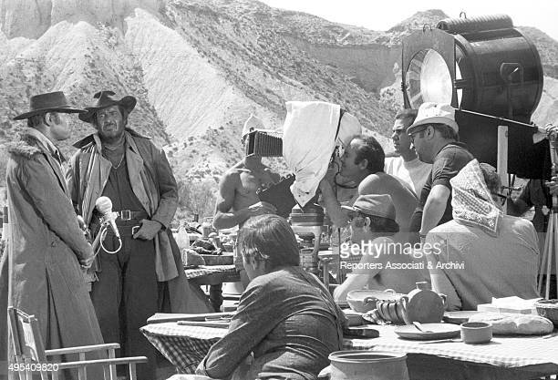 Italian director Sergio Leone directing American actors Henry Fonda and Jason Robards on the set of the film Once Upon a Time in the West 1968
