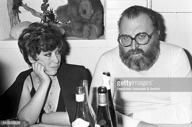 Italian director Sergio Leone having dinner with his wife Carla 1977